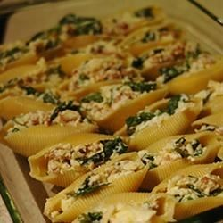 Cheesy Stuffed Shells Recipe - This is a delicious baked pasta dish with large shells filled with meat, spinach and cheese that children always seem to love. It is kind of a 'spaghetti that behaves itself!'