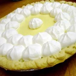 Key Lime Pie I Recipe - Beaten egg whites are carefully folded into the lovely lime filling to create a light and airy texture. The pie is baked in a graham cracker crust, frozen and topped with freshly whipped cream just before serving.