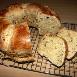Babka I Recipe - This Polish holiday bread is loaded with dried fruit, almonds, and fresh lemon and orange zests. It's topped with a cinnamon-sugar streusel. The recipe makes 3 large loaves.