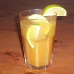 Caribbean Rum Punch Recipe - This delicious concoction is the traditional rum punch recipe used in the West Indies, passed down for years. The old rhyme goes, 'One of sour, two of sweet, three of strong, four of weak.'