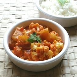 Gobi Aloo (Indian Style Cauliflower with Potatoes) Recipe - Cauliflower, potatoes, and an enticingly fragrant blend of spices make up this traditional Indian dish.