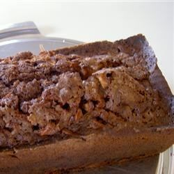 Cocoa Apple Cake Recipe - This moist Bundt cake is made with fresh grated apple, spices, chocolate chips, and a hint of cocoa powder.