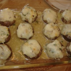 Stuffed Mushrooms with Swiss Cheese Recipe - Swiss cheese tops these mushrooms stuffed with a creamy mixture flavored with onion and parsley.