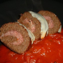 Sicilian Meat Roll Recipe - Ground beef seasoned with oregano and garlic, shaped into a rectangle, layered with ham and mozzarella cheese, then rolled up and baked.