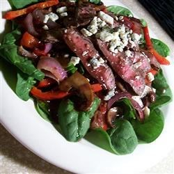 Flat Iron Steak and Spinach Salad Recipe - Spinach is topped with peppers, mushrooms and steak in this recipe.