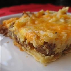 Breakfast Pizza I Recipe - A crust made from dinner roll dough with sausage, hash browns and cheese on top.