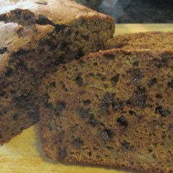 Chocolate-Cinnamon Zucchini Bread Recipe - Cinnamon chips add a fall flavor to a chocolate zucchini bread. Applesauce in the batter adds moistness and stands in for fat, and whole wheat flour gives a nutty flavor and hearty texture.