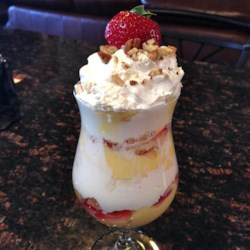 Angel Food Trifle Recipe - Angel food cake pieces are layered with vanilla pudding, strawberries, pineapple, and whipped topping creating quick and colorful trifle perfect for parties and showers.