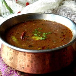 Dal Makhani (Indian Lentils) Recipe - These richly spiced lentils are simmered for two hours in a spicy tomato sauce and finished with splash of cream for a filling side dish.