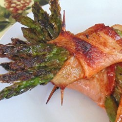 Bacon-Wrapped Sriracha Asparagus Recipe - A new way to enjoy fresh asparagus; wrap it in bacon with a little sriracha sauce and cook it on the grill!
