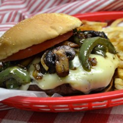 Eddie's Special Burgers Recipe - Hamburgers made with sauteed onions, green peppers and mushrooms, topped with mozzarella cheese and Italian-style dressing.