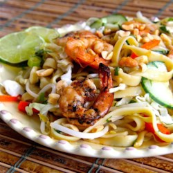 Saigon Noodle Salad Recipe - When it's too hot to cook this summer, use some leftover grilled shrimp, rice noodles, vegetables, herbs, and homemade dressing for a Vietnamese-style salad.