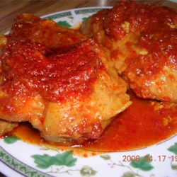 Bou's Chicken Recipe - Chicken simmered in a piquant sauce of mustard, soy sauce, vinegar and ketchup pairs nicely with rice or mashed potatoes on the side.