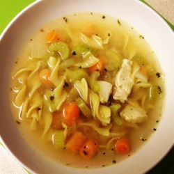 Quick and Easy Chicken Noodle Soup Recipe - Egg noodles, carrots, celery, and chicken are simmered in broth seasoned with basil and oregano. Chicken noodle soup in 30 minutes!