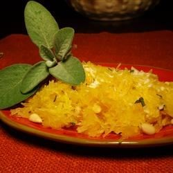 Spaghetti Squash with Pine Nuts, Sage, and Romano Recipe - Spaghetti squash lives up to its name by standing in for pasta in this vegetarian-friendly recipe for a delicious main or side dish.