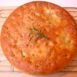 Parmesan Focaccia Bread Recipe - A delicious savory round loaf, with parmesan and olive oil.