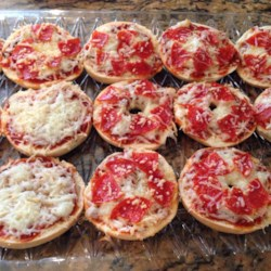 Easy Mini Bagel Pizzas Recipe - Mini pizza bagels make a quick and easy meal kids and adults will love to create for themselves.
