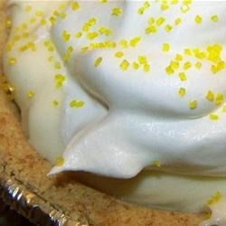 Easy Lemon Cheesecake Recipe - Lemon pudding becomes a luscious filling for this delicious pie. When the pudding comes to a simmer, cream cheese and sugar are stirred in, and when perfectly combined, the yummy filling is poured into a graham cracker crust and chilled.