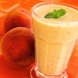Georgia Peach Smoothie Recipe - Peaches, yogurt, and coconut milk are blended together creating a creamy and satisfying peach smoothie that is great for a post-workout boost.