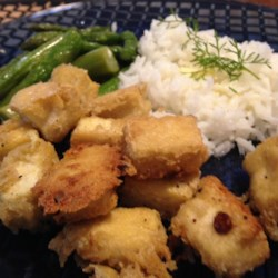 Tahini-Battered Tofu Recipe - Tofu with a light sesame, garlic, and whole wheat batter that can be baked or fried.  Great results with little to no oil.  My husband likes this recipe.