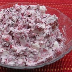 Lydia's Cranberry Salad Recipe -  Sugared ground cranberries are chilled overnight and mixed with miniature marshmallows, pecans and red grapes. Just before serving, whipped topping is folded in.