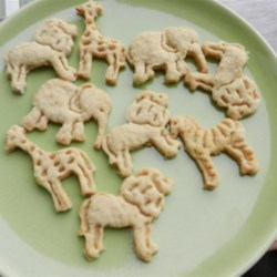 Animal Crackers Recipe - Make your own animal crackers! Cut these tasty not-too-sweet cookies into animal shapes. Made with buttermilk, oats and honey.
