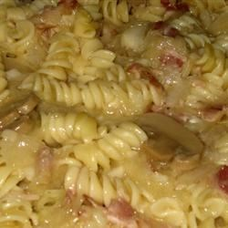 Lazy Man's Pierogi Recipe - An easy substitute for the Polish dish pierogi. Spiral twist pasta and bacon are combined with onions, mushrooms and cream of mushroom soup.