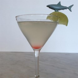 Great White Cocktail Recipe - This is basically a white Cosmopolitan, but a fun and delicious drink to serve during Shark Week.