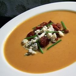 Velvety Pumpkin Soup With Blue Cheese and Bacon Recipe - Blue cheese and bacon top this chicken-stock based soup flavored with canned pumpkin, molasses, and cayenne pepper.