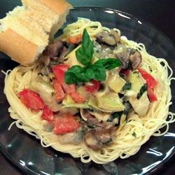 Tomato Alfredo Sauce with Artichokes Recipe - Use flour and milk to make a sauce with canned artichoke hearts, then cook the sauce briefly with onions, mushrooms, fresh tomatoes and chopped basil. Toss with cooked pasta and enjoy a fresh and flavorful dish.