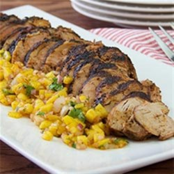 Chili-Rubbed Pork with Mango Salsa Recipe - Chili-rubbed pork tenderloin gets a flavorful crust when cooked on the grill. Top with a mango salsa for a delectable summertime dinner on the patio.