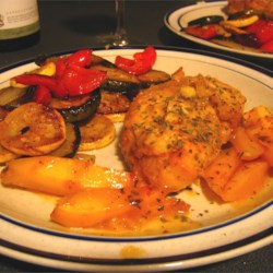 Caribbean Chicken Recipe - Chicken breast is coated in a delicately spiced, and slightly sweet breading, then baked with grapefruit juice and nectarine.