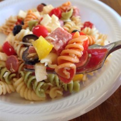 Awesome Pasta Salad Recipe and Video - This pasta salad, made with Provolone, salami, pepperoni, bell peppers, and black olives tossed with fusili pasta and Italian salad dressing, is very easy to make.