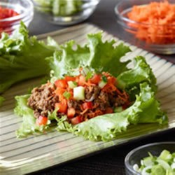 Asian Lettuce Wraps Recipe - Packed with crunchy veggies, these colourful lettuce wraps are flavoured with fresh ginger, sesame oil and hoisin sauce.