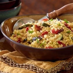 Couscous with Roasted Tuscan Inspired Vegetables Recipe - This hearty, vegetarian main dish couscous features a European-inspired vegetable blend of roasted potatoes, zucchini and eggplant.