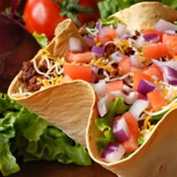 Tasty Taco Salad Recipe - Tortilla shells are baked, not fried, then filled with spicy Mexican Veggie Ground Round in this twist on taco salad.