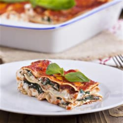 Veggie Lasagna Recipe - Delicate layered spinach lasagna with vegetarian tomato-basil sauce uses oven-ready noodles for easy preparation.