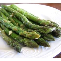 Sauteed Garlic Asparagus Recipe and Video - Asparagus is simply sauteed in butter with garlic. A simple but tasty twist to regular old Asparagus.