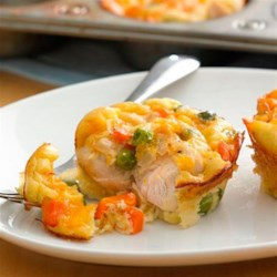 Impossibly Easy Mini Chicken Pot Pies Recipe - Enjoy this chicken pot pie filled with peas and carrots – a delightful dinner made using Original Bisquick(R) mix.