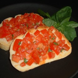 Bruschetta al Pomodoro Recipe - This is a delicious way to use all the extra tomatoes and basil growing in the garden. Buon appetito!