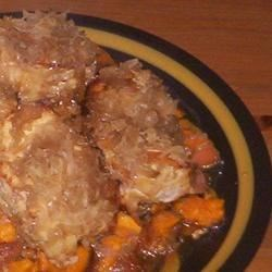 Pork Chops with Apples, Sweet Potatoes, and Sauerkraut Recipe - This sweet yet savory medley of apples, sweet potatoes, onions, and sauerkraut cooks up perfectly in the slow cooker! Don't be afraid of the sauerkraut---it becomes sweet and mild.