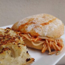 Grilled Spaghetti Sandwich Recipe - You've heard of the spaghetti taco, but have you had the spaghetti sandwich?! Grilled hoagie rolls stuffed with pasta, sauce, and cheese are surprisingly delicious!