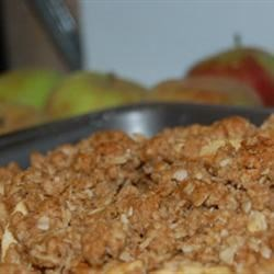 Apple Crisp IV Recipe - Three layers make up this hearty 9x13-inch crisp. Sweet apple slices find their home between generous layers of a delicious crumbly mixture -flour, brown sugar, butter, cinnamon and oatmeal.