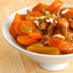 Carrots with Apricot Preserves Recipe - This tangy, fruity side dish looks beautiful served hot out of the oven. If you don't want to heat up the oven, the carrots are pretty good simply simmered for 5 minutes in the sauce.