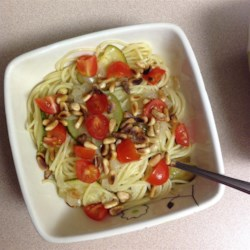 Zucchini Pasta with Pine Nuts Recipe - Zucchini pasta topped with Parmesan cheese, pine nuts, and tomatoes is a quick, Italian-inspired meal for any night of the week.