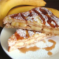 Peanut Butter and Banana French Toast Recipe - An unique and delicious recipe that my mom used to make. It is so easy that even kids can help to make it. Serve it hot with butter or margarine and syrup.