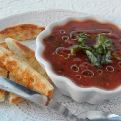 Tomato Basil Soup II Recipe - Tomatoes, basil, chicken broth and olive oil are chilled together in this cold soup.
