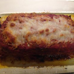 EZ Meatloaf Recipe - This baked American favorite, consisting of ground beef, bread stuffing mix and onions, then covered in pasta sauce, is a great way to feed a large group without a lot of hassle. Freeze half of it so you can enjoy a quick meal later.