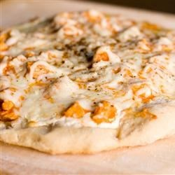 Buffalo Style Chicken Pizza Recipe - Hot sauce, blue cheese dressing and mozzarella cheese top cubed chicken and a pizza crust for this Buffalo lovers' must!