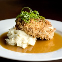 Bourbon Pecan Chicken Recipe - Chicken breasts are coated in a pecan breading, and fried in a skillet. Then a rich bourbon sauce is poured over them before serving. This is a fabulous recipe that my Mother gave me from a upscale restaurant in New York. It is to die for. ENJOY!!